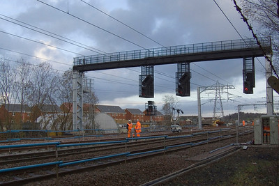 Work taking place at Elderslie to upgrade track and extend the loop line. The new gantry incorporating signalling for the revised layout is now operational.