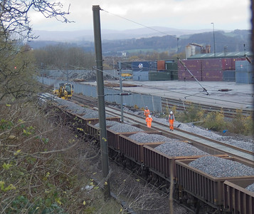 Ballast train alongside the WHM freight depot at Elderslie during track replacement and upgrading work. New track to the right is already in place and awaiting the attention of the tamper.