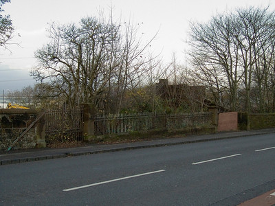 Main Road in Elderslie. The bricked up remains are the entrance to Elderslie station, which was closed in 1966.