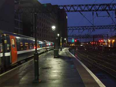 DVT 82228 at the head of a service to London Kings Cross in it's new NXEC branding departing after being given signals