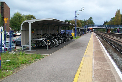 Typical of stations in this part of the world, three sheds with customers bikes, all full
