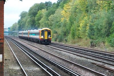 A Class 159 unit about ot run through Fleet at high speed on the fast up line