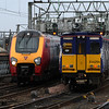 314204 departing on a service to Neilston passing 221118 as it arrives from Birmingham New Street