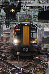380113 crossing the points as it draws into P10 of Glasgow Central