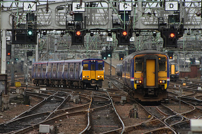 314208 and 156465 outside Glasgow Central