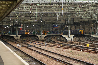 A mix of traction at Glasgow Central, with a Class 156, Class 158, Class 314 and Class 380 on show