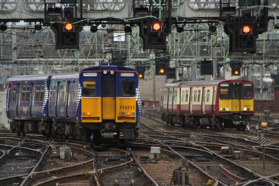 314211 departing Glasgow Central on a Newton service with 314209 waiting on lights to proceed to Glasgow Central