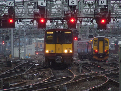 314210 on approach to Glasgow Central