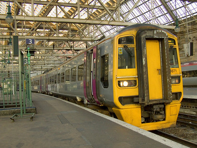 158871 at Glasgow Central in Alphaline livery waiting to depart on a service to Edinburgh Waverly