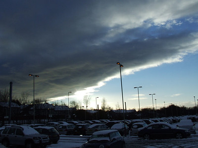 Cloud clearing after a heavy snowfall. Looking over Johnstone Station car park