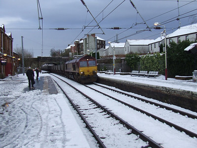 66084 thundering through Johnstone en route to Hunterston after a heavy snow fall