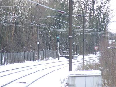 Green light in the snow outside Johnstone Station