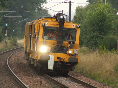 Network Rail Harsco Switch and Crossing stoneblower DR 80303 passing through Johnstone