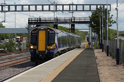 380018 racing through Cardonald Station on a service to Ardrossan Harbour