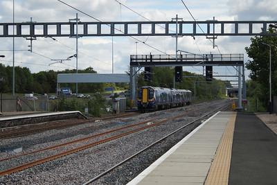 380017 passing through Cardonald with a Glasgow Central service