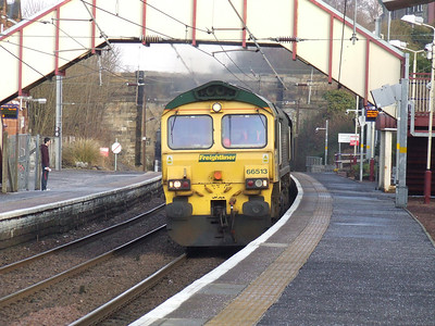 66513 about to thunder thorugh Johnstone with an empty coal train going from Fiddlers Ferry PS to Hunterston