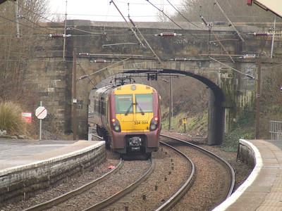 334024 departing Johnstone on a service to Glasgow Central