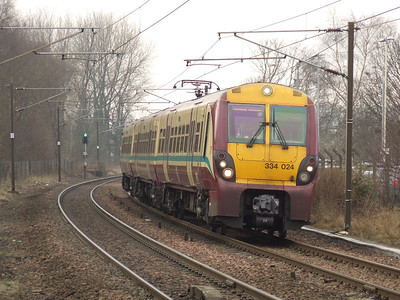 334024 drawing into Johnstone on a service to Glasgow Central