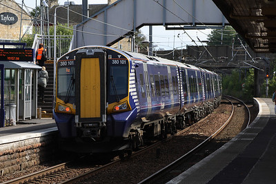 380101 at the rear of an Ayr service departing Kilwinning