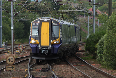 380112 approaching Kilwinning with a service for Largs