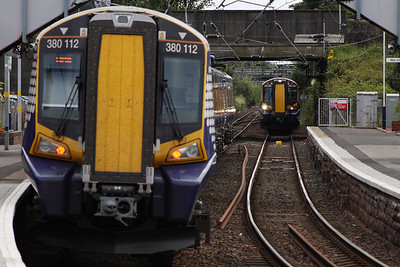 380112 waiting to depart for Largs with 380005 approaching Kilwinning with a service for Glasgow Central