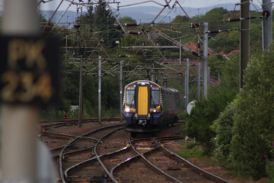 380010 at the head of an Ayr service approaching Kilwinning