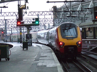 De-branded 221124 departs Glasgow Central with a Cross Country service to Exeter St Davids
