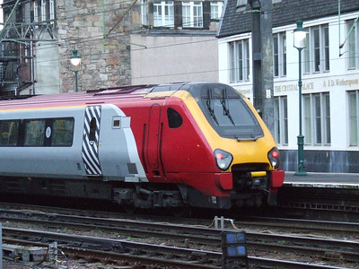 De-branded 221124 drawing into Glasgow Central to form a Cross Country service