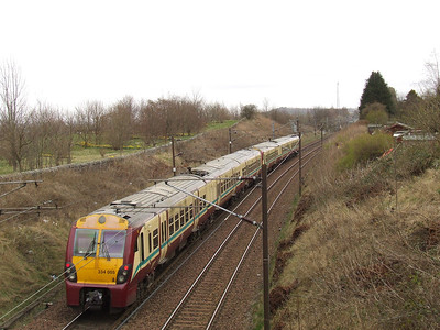 334005 on a Glasgow Central service passing through Elderslie at the rear of a two unit set
