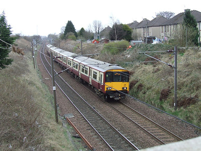 318257 on an Ayr service passing through Elderslie at the head of a two unit set
