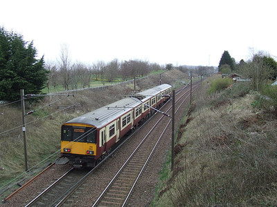 318262 on a Glasgow Central service passing through Elderslie