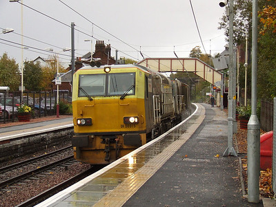 MPV DR98915 at the head of a rail head treatment train passing through Johnstone station