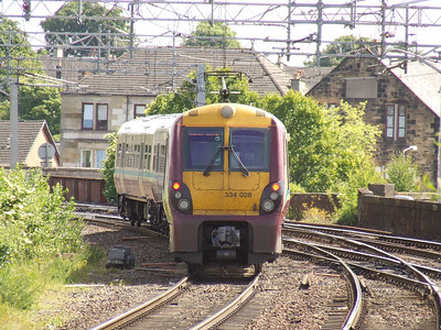 334026 departing P1 on a Glasgow Central service