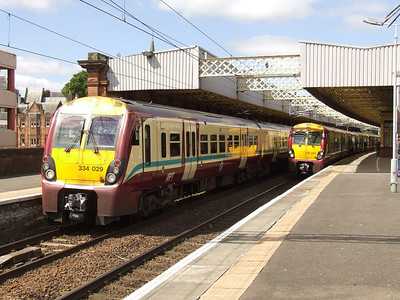 334028 at P3 with a Glasgow Central service and 334029 at P4 on the rear of a service to Largs