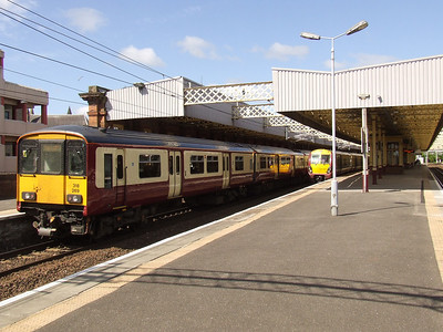 318269 on an Ardrossan Town service at P4 and 334030 at P3 on a Glasgow Central service