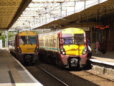 334027 at P2 on a Gourock service and 334014 at P1 with a Glasgow Central service