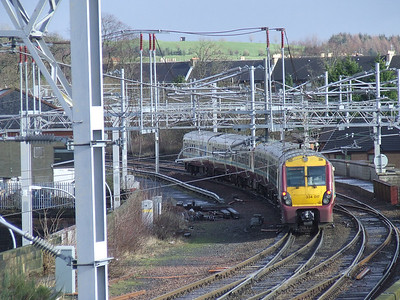 334017 at the rear of a two unit set on a Glasgow Central service crossing Wallneuk Junction