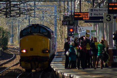 37218, 37607 DRS Paisley Gilmour Street 09/03/2016 Note the crowd gathered on Platform 3. This is local SNP, Green Party and CND activists protesting aginst the service.