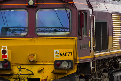 66077 Benjamin Gimbert GC DBS (EWS livery) Paisley Gilmour Street 11/08/2015 On 1st August 2015 2 engineers trains collided at New Cumnock during engineering works to replace railway track. As well as 18 wagons and one of the engines derailing, it also damaged much of the two tracks which had to then be completely replaced. This had the effect of closing the line between Kilmarnock and Dumfries for a substantial time. The train in this picture is transporting old ballast and track from the site, and came via Barrasie.