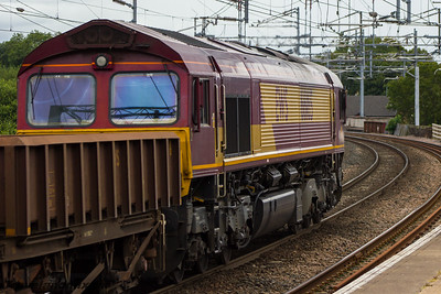 66165 DBS (EWS livery) Paisley Gilmour Street 13/08/2015 On 1st August 2015 2 engineers trains collided at New Cumnock during engineering works to replace railway track. As well as 18 wagons and one of the engines derailing, it also damaged much of the two tracks which had to then be completely replaced. This had the effect of closing the line between Kilmarnock and Dumfries for a substantial time. The train in this picture is transporting old ballast and track from the site, and came via Barrasie.