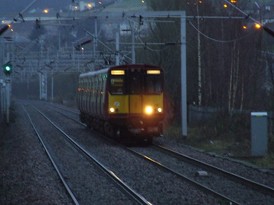 314213 approaching Cartsdyke at dusk on a fast service from Glasgow to Gourock