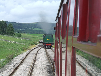 No.17 at the end of the loop about to run round the coaches. Beyond the buffers is the trackbed to Grantown On Spey which has been secured by the Speyside Railway for future use