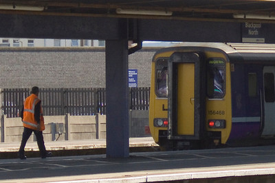 156468 coming to rest at Platform 3 of Blackpool North, with the train care crew in close attandance