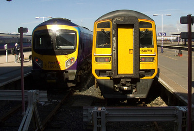 185122 and 158851 at the buffer stops of Platform 6 & 7 of Blackpool North