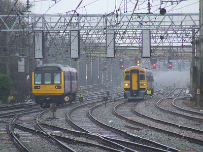 142056 heading South with a service for Ormskirk and 158817 heading North with a Blackpool North service