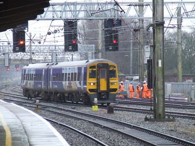 158909 passing drawing into Preston with a Blackpool North service