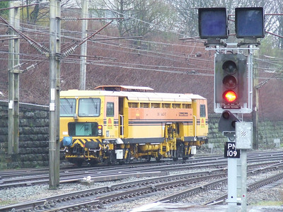 Colas Rail tamper DR73913 joining the main line to the South afte having been given signals to proceed