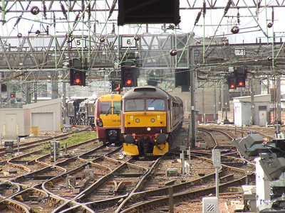 47760 arriving at Glasgow Central hauling the Great Britiain II coaching stock with 45231 and 45407 on the rear.