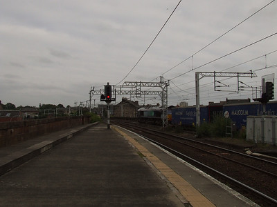 66401 passing through Paisley Gilmour Street with the WH Macolm container service from Elderslie to Newbiggin, Cumbria