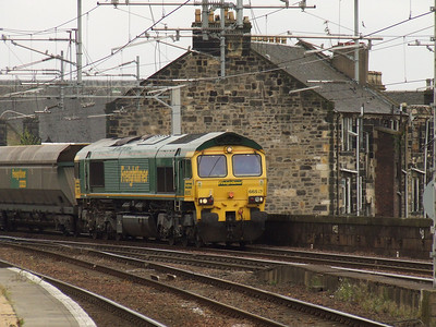 66513 about to pass through Paisely Gilmour Street with empty coal hoppers